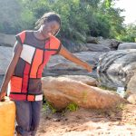 The Water Project: Kasekini Community A -  Hauling Water