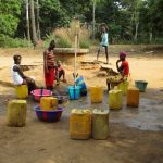 The Water Project: Kamayea, Susu Community & Church -  Fetching Water