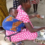 The Water Project: Kamayea, Susu Community & Church -  Woman Selling Food