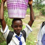 The Water Project: Lokomasama, Musiya, Nelson Mandela Secondary School -  Girl Carrying Water