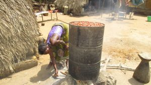 The Water Project:  Old Woman Cooking Palm Kernels