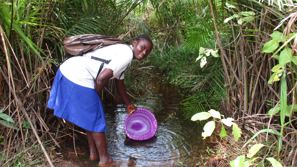 The Water Project : sierraleone19262-student-fetching-water