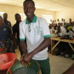 The Water Project: UBA Senior Secondary School -  A Student Demonstrating One Of The Three Handwashing Methods