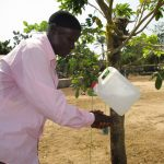 The Water Project: UBA Senior Secondary School -  Headman Using Tippy Tap