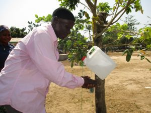 The Water Project:  Headman Using Tippy Tap