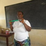 The Water Project: UBA Senior Secondary School -  Hygiene Facilitator Teaching The Participants How To Use Tooth Brush