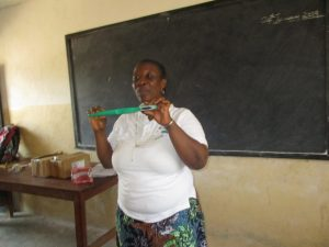 The Water Project:  Hygiene Facilitator Teaching The Participants How To Use Tooth Brush