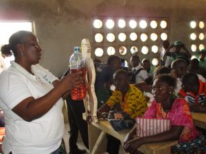 The Water Project:  Hygiene Facilitator Uses A Doll To Teach About Diarrhea