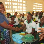 The Water Project: UBA Senior Secondary School -  Shaking Hands With Glitter To Show The Spread Of Germs