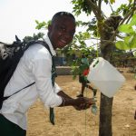 The Water Project: UBA Senior Secondary School -  Student Demonstrating Hand Washing System