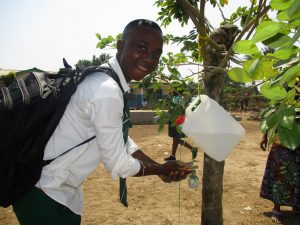 The Water Project:  Student Demonstrating Hand Washing System