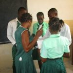 The Water Project: UBA Senior Secondary School -  Students Arranging Disease Transmission Posters In Order
