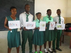 The Water Project:  Students Participate In Training By Holding Learning Materials