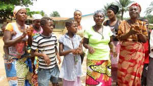 The Water Project:  Community Member Singing And Celebrating Safe Drinking Water
