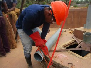 The Water Project:  Cutting Pipe
