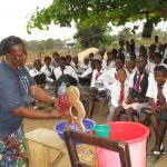 The Water Project: Rowana Junior Secondary School -  Hygiene Facilitator Teaching About Diarrhea Through Diarrhea Doll