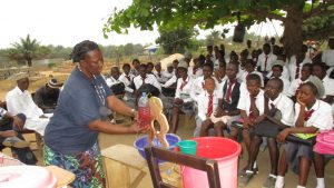 The Water Project:  Hygiene Facilitator Teaching About Diarrhea Through Diarrhea Doll