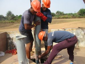The Water Project:  Inserting Casing