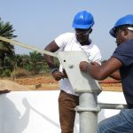 The Water Project: Rowana Junior Secondary School -  Installing Pump