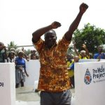 The Water Project: Rowana Junior Secondary School -  Mr David S Conteh School Principal Celebrating Safe Drinking Water