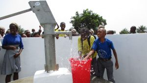 The Water Project:  Student Playing With Clean Water