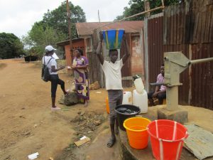 The Water Project:  Carrying Water From Community Well