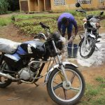 The Water Project: Lungi, Rotifunk, 1 Aminata Lane -  Washing Motorcycle