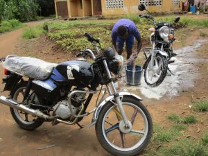 The Water Project:  Washing Motorcycle