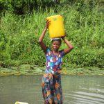 The Water Project: Lokomasama, Gbonkogbonko, Kankalay Primary School -  Carrying Water