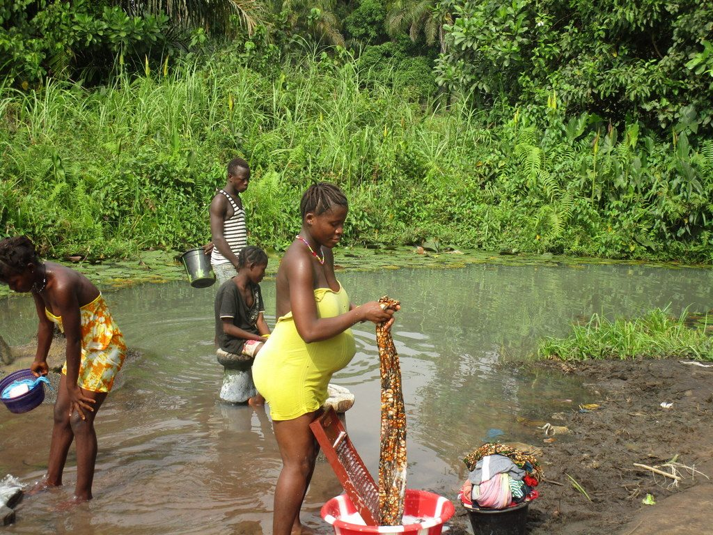The Water Project : sierraleone19272-community-activity-community-members-laundring