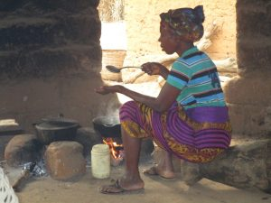 The Water Project:  Community Activity Old Woman Cooking