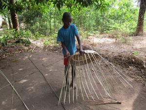 The Water Project:  Community Activity Young Boy Preparing Basket