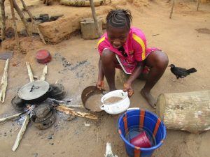 The Water Project:  Community Activity Young Lady Cooking