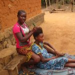 The Water Project: Lokomasama, Gbonkogbonko, Kankalay Primary School -  Community Activity Young Lady Plating Hair