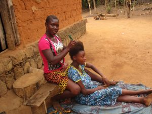 The Water Project:  Community Activity Young Lady Plating Hair