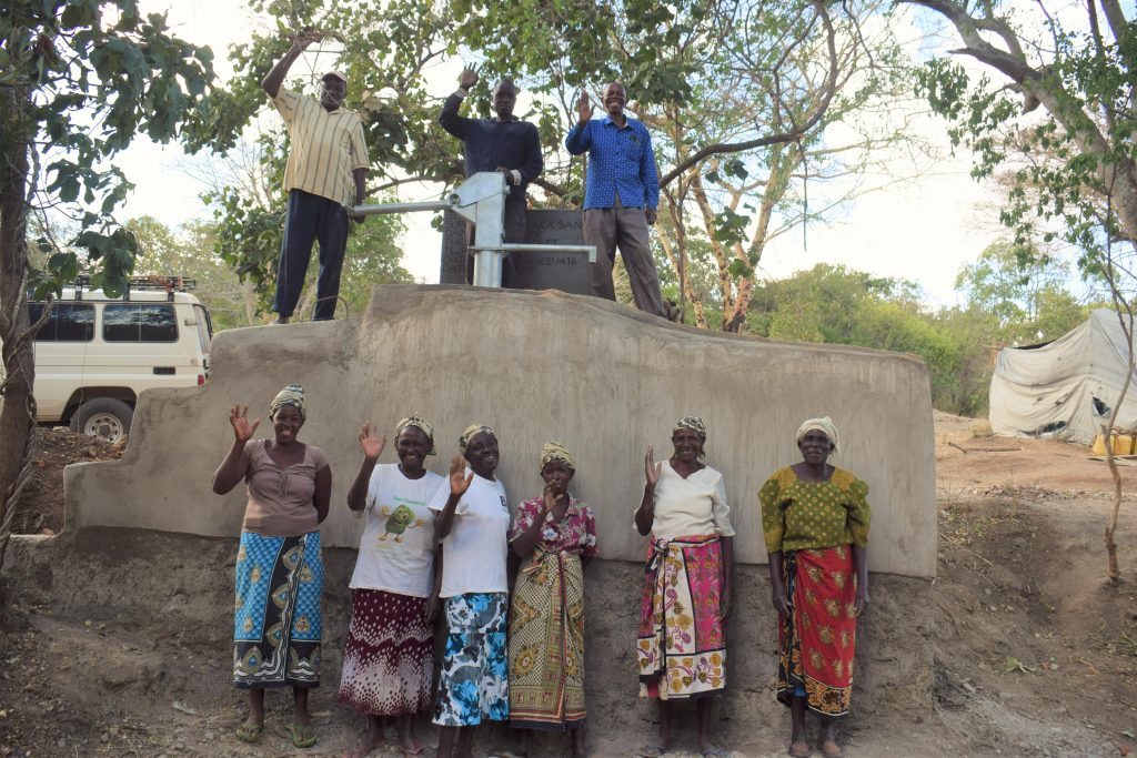 The Water Project : kenya19210-community-members-celebrating-the-finished-well