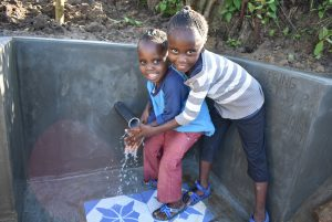 The Water Project:  Water And Smiles Give Life