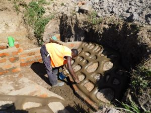 The Water Project:  Finishing The Stone Wall