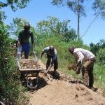 The Water Project: Musango Community, Mushikhulu Spring -  Community Members Gathering Stones For Construction