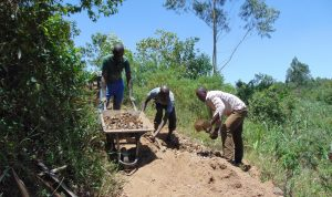 The Water Project:  Community Members Gathering Stones For Construction