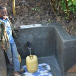 The Water Project: Eshiakhulo Community, Kweyu Spring -  Filling Up