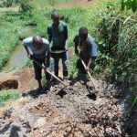 The Water Project: Musango Community, Mushikhulu Spring -  Mixing Cement