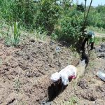 The Water Project: Mukhuyu Community, Kwakhalakayi Spring -  Digging Drainage