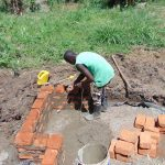 The Water Project: Musango Community, Mushikhulu Spring -  Taking Measurements
