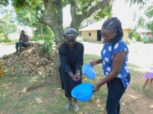 The Water Project:  Practicing Handwashing