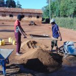 The Water Project: Kima Primary School -  Sieving Sand
