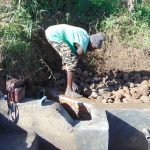 The Water Project: Musango Community, Mushikhulu Spring -  Backfilling