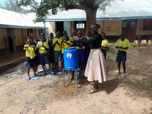 The Water Project:  Trainer Leads Handwashing Activity