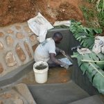 The Water Project: Shisere Community, Francis Atema Spring -  Installing The Tiles