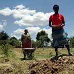 The Water Project: Mukhuyu Community, Kwawanzala Spring -  Transporting Materials To The Spring